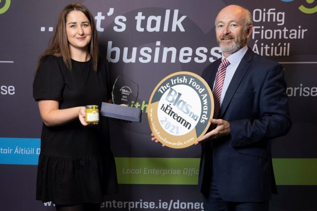 Grace Shields accepting the award on behalf of Filligans from Michael Tunney.